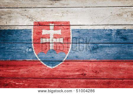 slovakian flag on wood texture background