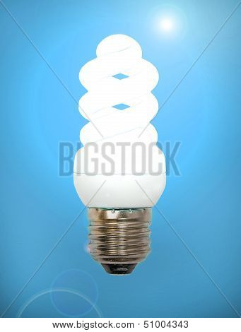 Energy Save Lamp On A Blue Background.