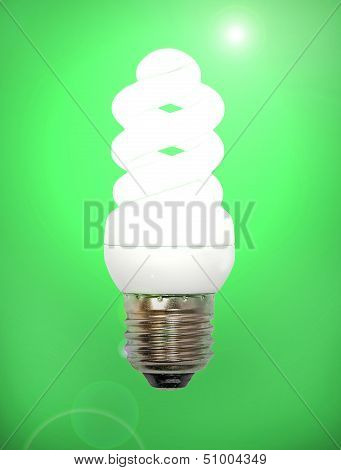 Energy Save Lamp On Green Background.