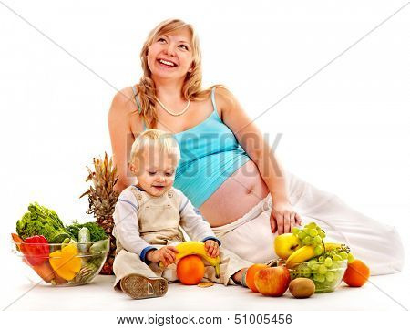 Pregnant woman eating fruit eating. Isolated.