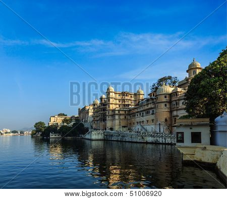 Romantic India luxury tourism concept background - Udaipur City Palace and Lake Pichola. Udaipur, Rajasthan, India