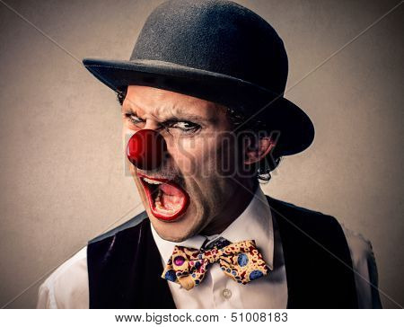 portrait of a clown with a bowler hat grimacing