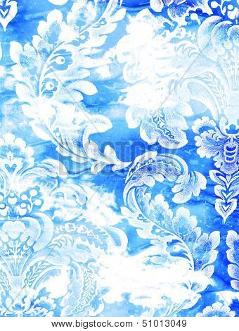 Abstract textured background: white floral patterns on blue backdrop. For art texture, grunge design, and vintage paper / border frame