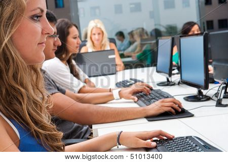 Internship Students Working In Office.