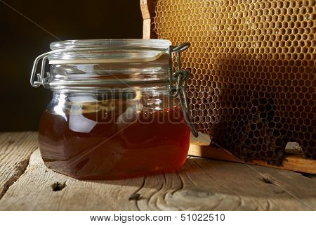 Honeycomb With Fresh Honey In A Vase On Wooden Table.