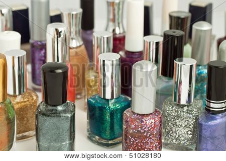 Large collection of assorted colored nail polish