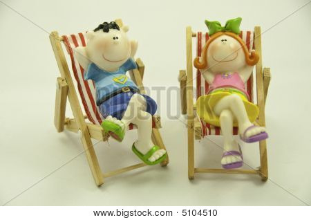 Boy And Girl On Chair