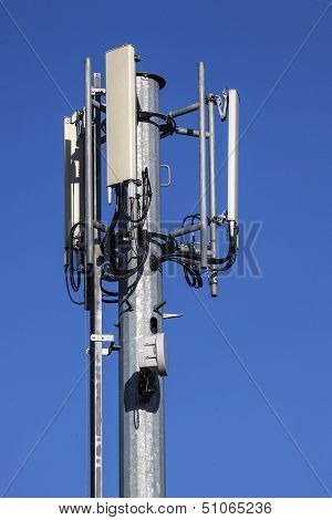 Cell Tower And Radio Antenna On Blue Sky