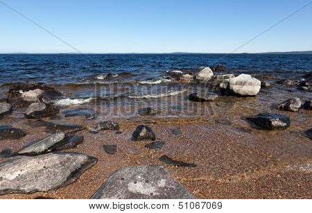 Large Gray Rocks On The Shore Of Lake
