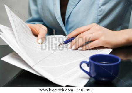 Businesswoman Working With Financial Reports.