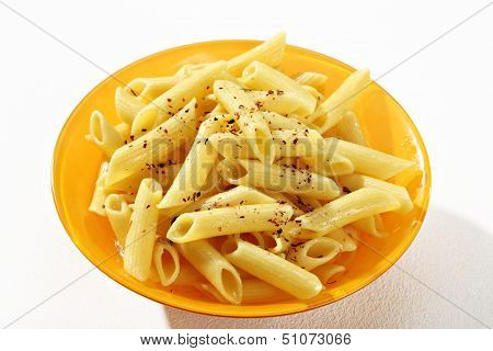 Cooked penne pasta on a plate