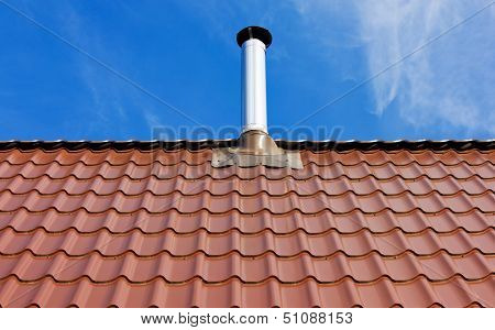 Red Tile Roof With A Tin Chimney