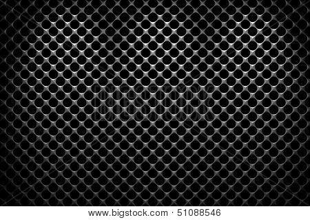 Steel Grid With Round Holes Under Three Spot Lights