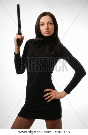 Cool Brunette In Close Black With Gun