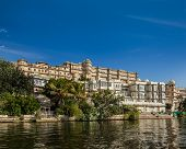 India luxury tourism concept background - Udaipur City Palace from Lake Pichola. Udaipur, Rajasthan,