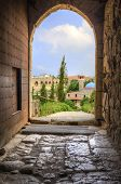 stock photo of crusader  - The historic city of Byblos in Lebanon viewed from the gate entrance of the crusaders - JPG