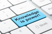 Education concept: Knowledge Is power! on computer keyboard back