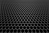 stock photo of metal grate  - Steel grid with hexagonal holes and reflection on black background in perspective view - JPG