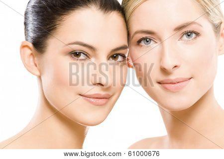 studio portrait of two young beautiful women