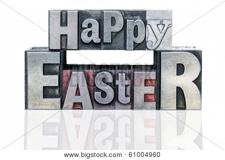 Happy Easter in old metal letterpress printing blocks with mixed font, isolated on a white background.
