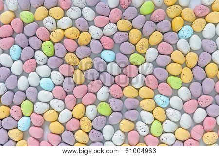 Lots of candy covered multi coloured mini chocolate Easter eggs