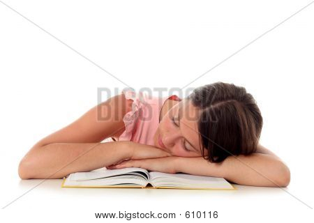 Girl Sleeping With Her Head On An Open Book