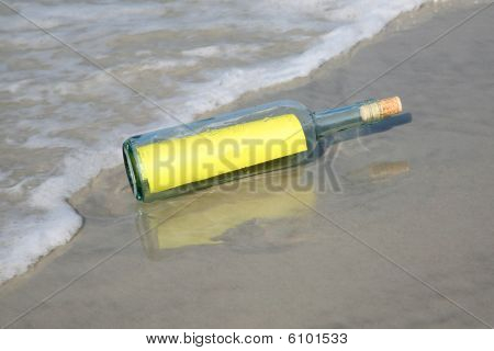 Message In A Bottle Floating In The Surf
