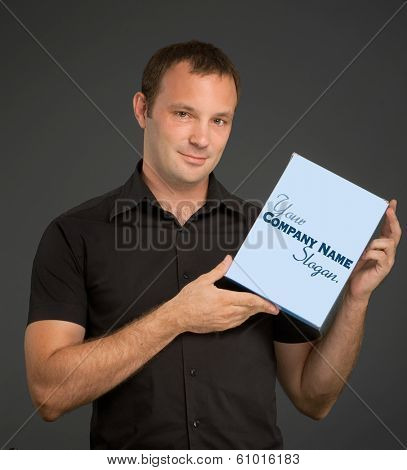 Man in black holding a blank box