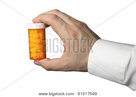 Hand holding a bottle of pills on white background