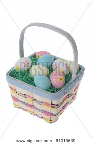 Easter basket with grass and colored dyed eggs