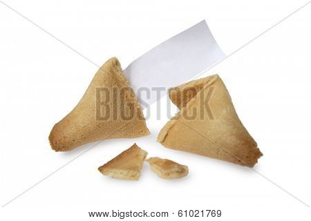 Broken fortune cookie with blank piece of paper on white