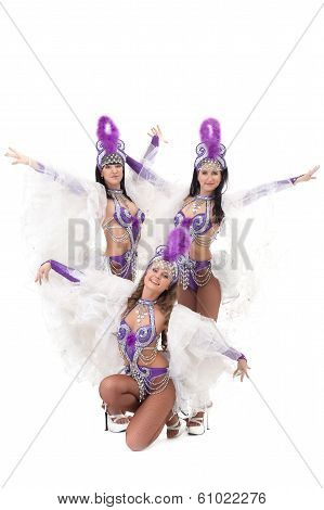 Trio of hot samba dancers isolated on white