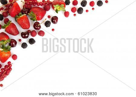 frame border or edge of red fresh summer fruits with copy space