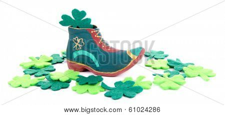 Saint Patrick day boot and clover leaves, isolated on white