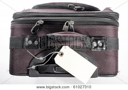 Worn Suitcase With Tag