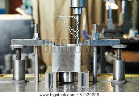 Close up machining tool drill during metal cutting process boring a hole
