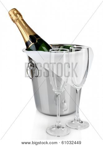 Bottle of champagne in pail and empty glasses, isolated on white