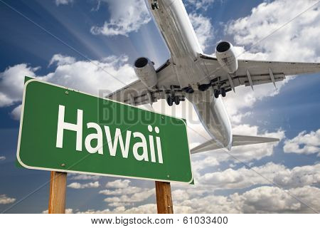 Hawaii Green Road Sign and Airplane Above with Dramatic Blue Sky and Clouds.