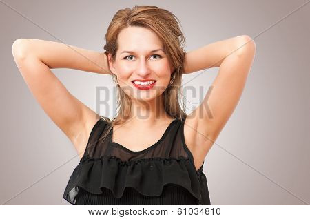 a beautiful woman posing and smiling coquettishly.