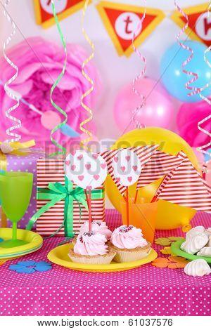 Festive table setting for birthday on celebratory decorations
