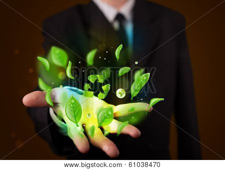 Young business man in suit presenting eco green leaf recycle energy concept