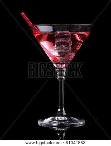 Red cocktail in martini glass isolated on black