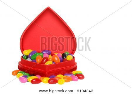Lots Of Jelly Beans In A Red Heart Box