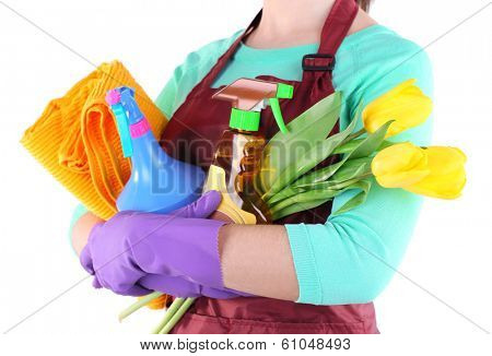 Housewife holding cleaning equipment in her hands. Conceptual photo of spring cleaning. Isolated on white