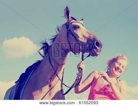 Portrait Of A Beautiful Young Woman And A Dun Horse