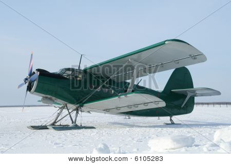 Plane With Skis On The Snow