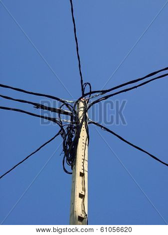 electrical pole with a bunch of cables