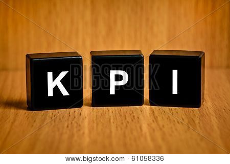 Kpi Or Key Performance Indicator Text On Block