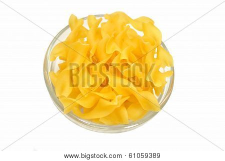 Egg Noodles In A Glass Bowl Over White
