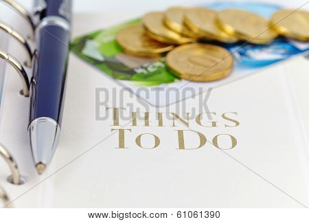 Credit Card, Golden Coins And Ball Pen On The Page Of An Organizer With The Words ''things To Do''.